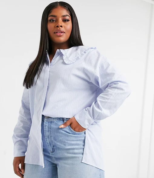 """This is one you'll definitely reach for once the office opens back up. $51, ASOS. <a href=""""https://www.asos.com/us/glamorous-curve/glamorous-curve-relaxed-shirt-in-blue-pinstripe-with-peter-pan-frill-collar/prd/21318317?"""" rel=""""nofollow noopener"""" target=""""_blank"""" data-ylk=""""slk:Get it now!"""" class=""""link rapid-noclick-resp"""">Get it now!</a>"""