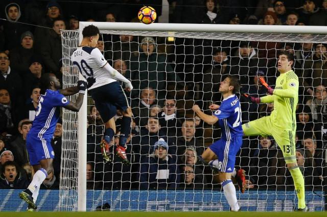 Tottenham Hotspur's midfielder Dele Alli (2nd L) jumps to score his and Totenham's second goal with this header during the English Premier League football match against Chelsea January 4, 2017 (AFP Photo/Adrian DENNIS)