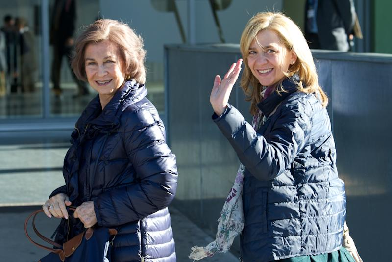 POZUELO DE ALARCON, SPAIN - NOVEMBER 23: Queen Sofia of Spain (L) and Princess Cristina of Spain (R) visit King Juan Carlos of Spain at the Quiron University Hospital on November 23, 2013 in Pozuelo de Alarcon, Spain. The Spanish King underwent an operation to get a final prosthesis on his left hip. The operation is the King's ninth in three years. (Photo by Carlos R. Alvarez/WireImage)