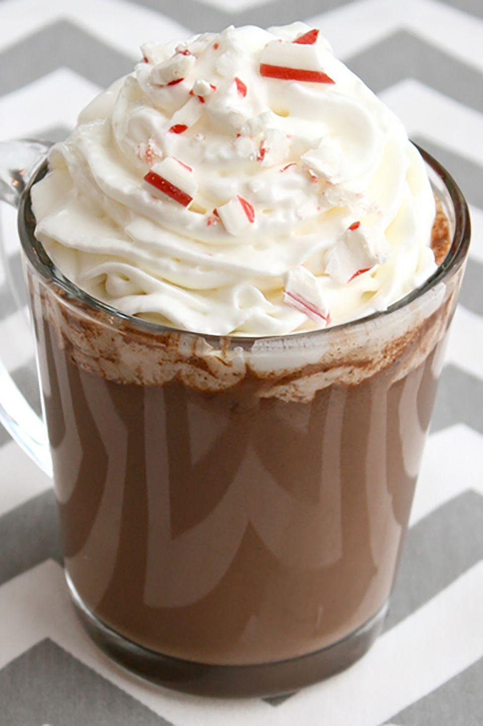 """<p>A little vodka or creme de menthe, and this classic holiday drink goes from kid-friendly to fully grown-up. And thanks to this slow cooker recipe, it stays warm for hours of sipping pleasure.</p><p><strong><a href=""""https://www.countryliving.com/food-drinks/recipes/a34524/slow-cooker-peppermint-bark-hot-chocolate-recipe-ghk1213/"""" rel=""""nofollow noopener"""" target=""""_blank"""" data-ylk=""""slk:Get the recipe"""" class=""""link rapid-noclick-resp"""">Get the recipe</a>.</strong> </p>"""