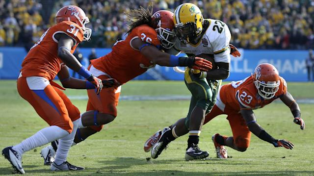 Sam Houston State's Michael Wade (31) Darius Taylor (36) and Robert Shaw (23) combine to tackle North Dakota State's Sam Ojuri (22) in the second half of the FCS Championship NCAA college football game Saturday, Jan. 5, 2013, in Frisco, Texas. (AP Photo/Tony Gutierrez)