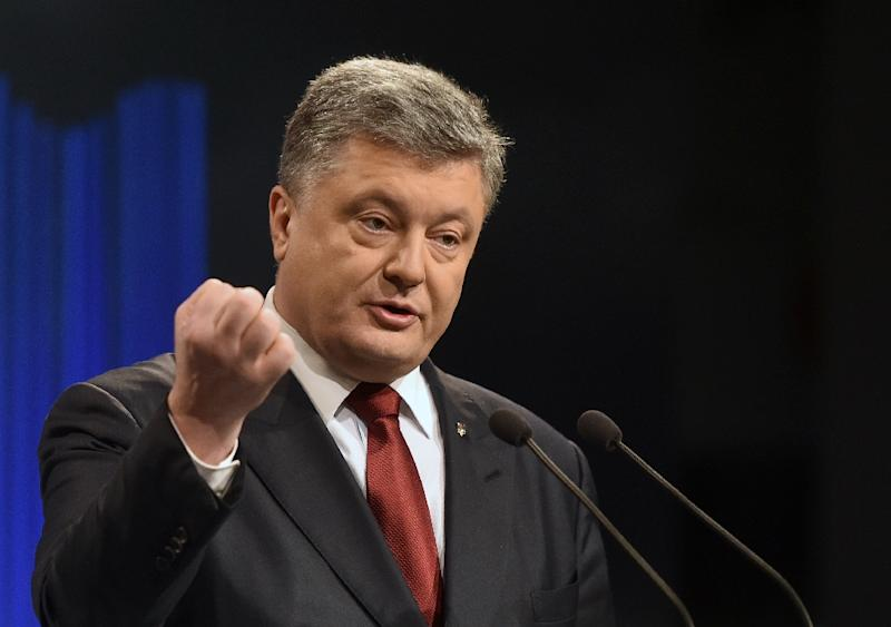 Ukrainian President Petro Poroshenko (pictured) has asked Prime Minister Arseniy Yatsenyuk to step down over his seeming failure to tackle government graft (AFP Photo/Genya Savilov)