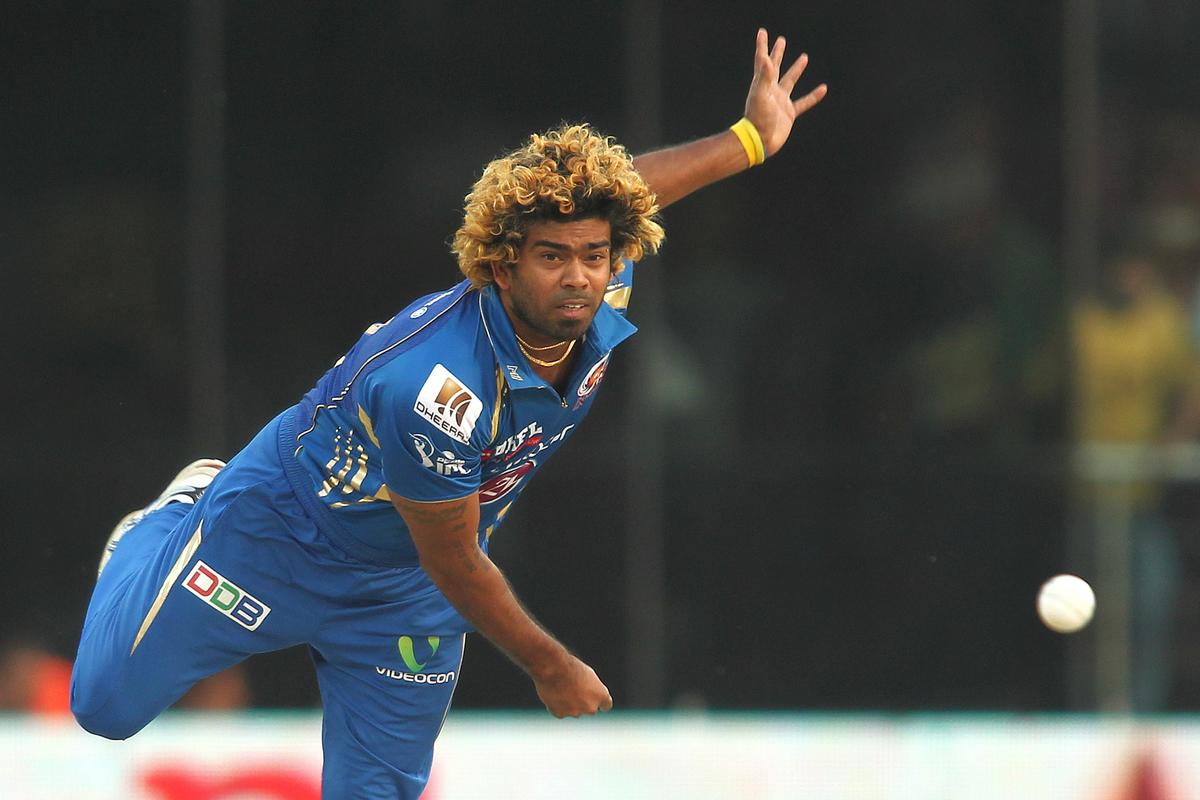 Lasith Malinga of Mumbai Indians sends down a delivery during match 28 of the Pepsi Indian Premier League between The Delhi Daredevils and the Mumbai Indians held at the Feroz Shah Kotla Stadium, Delhi on the 21st April 2013..Photo by Shaun Roy-IPL-SPORTZPICS ..Use of this image is subject to the terms and conditions as outlined by the BCCI. These terms can be found by following this link:..https://ec.yimg.com/ec?url=http%3a%2f%2fwww.sportzpics.co.za%2fimage%2fI0000SoRagM2cIEc&t=1498466382&sig=aOYfbJXS0jTSo11Zy.vzEA--~C