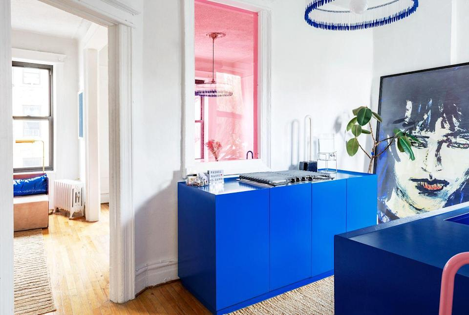 """<p>The interior window of this NYC apartment by <a href=""""https://bendheim.com/"""" rel=""""nofollow noopener"""" target=""""_blank"""" data-ylk=""""slk:Crosby Studios"""" class=""""link rapid-noclick-resp"""">Crosby Studios</a> gets the stained glass treatment, but 21st-century style. Many old apartment buildings have them because they were built to increase air circulation, and here's how to make them look intentional and incredibly stylish. He used cut-to-size plexiglass from a shop on Canal street and chose a fun bubble gum pink hue. </p>"""