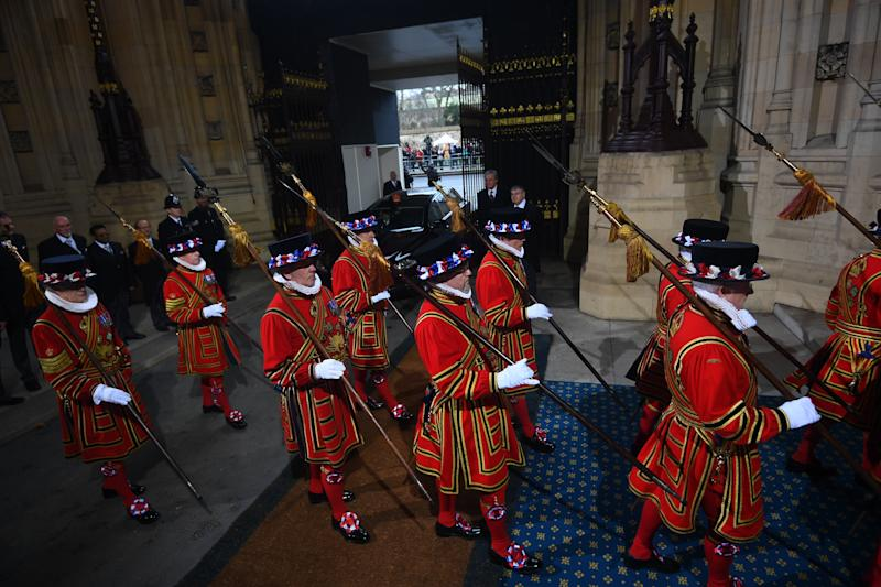 Yeoman warders parade through the Sovereign's entrance ahead of the State Opening of Parliament by Queen Elizabeth II, in the House of Lords at the Palace of Westminster in London.