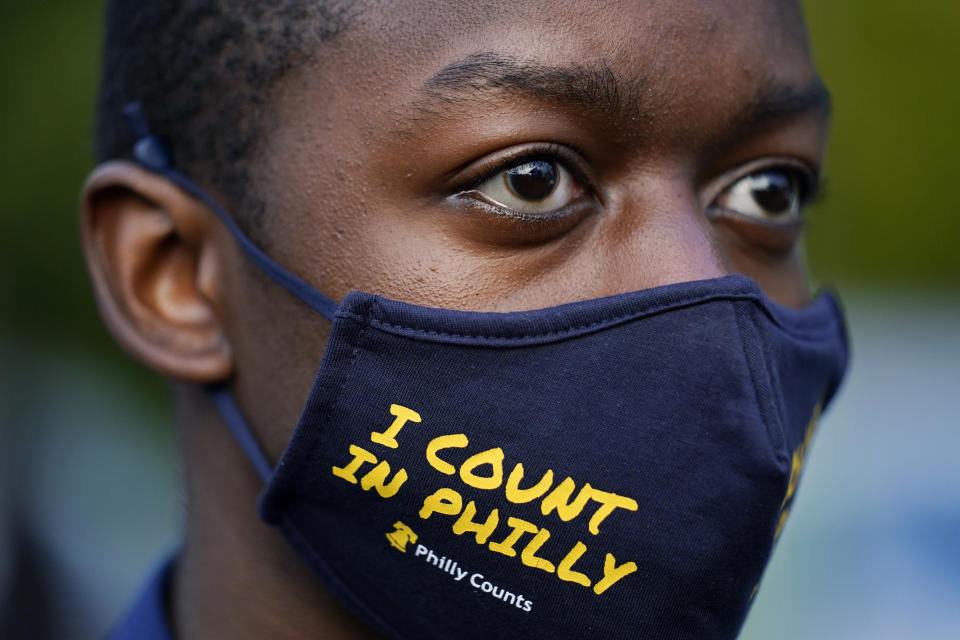 "A supporter listens as Democratic presidential candidate former Vice President Joe Biden speaks at a ""Souls to the Polls"" drive-in rally at Sharon Baptist Church, Sunday, Nov. 1, 2020, in Philadelphia. (AP Photo/Andrew Harnik)"