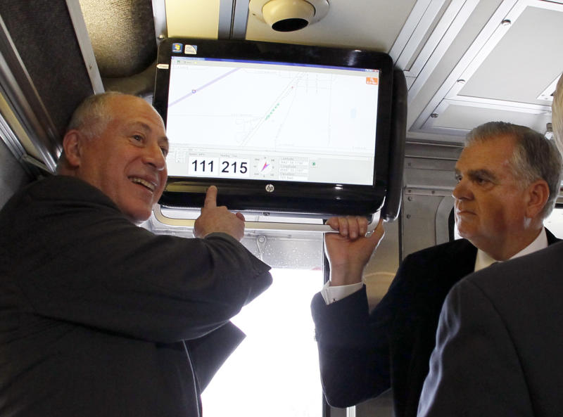 Illinois Gov. Pat Quinn, left, points out the speed of the Amtrak train that he and US Transportation Secretary Ray LaHood are riding as it reaches 111 mph on a test run between Dwight and Pontiac, Ill., Friday, Oct. 19, 2012, in Pontiac, Ill. (AP Photo/Charles Rex Arbogast)