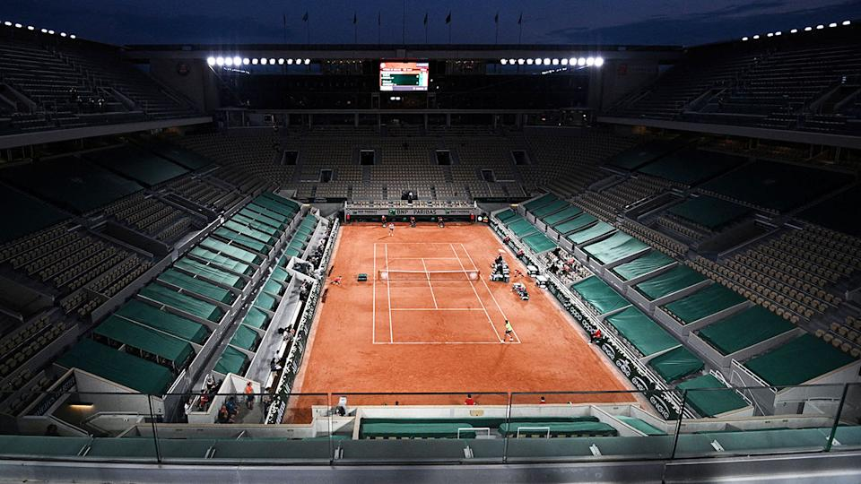Rafael Nadal and Richard Gasquet, pictured here playing in front of an empty stadium at the French Open.