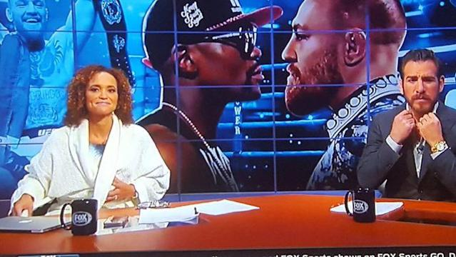 Fox broadcaster Karyn Bryant shown wearing a robe on live TV due to a Fox Sports glitch during the Floyd Mayweather-Conor McGregor newsconference. (Twitter)