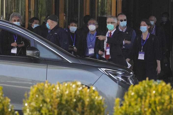 Members of the World Health Organization team of researchers prepare to leave on a field trip in Wuhan in central China's Hubei province Friday, Jan. 29, 2021. The World Health Organization team of researchers emerged from their hotel Thursday for the first time since their arrival in the central Chinese city of Wuhan to start searching for clues into the origins of the COVID-19 pandemic. (AP Photo/Ng Han Guan)