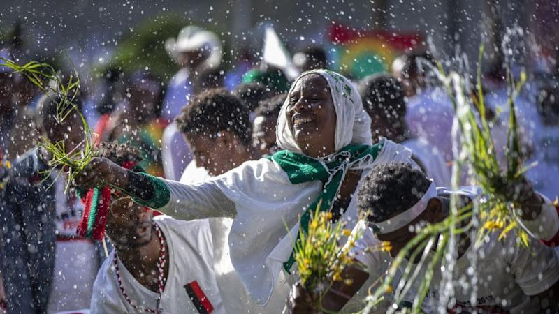 Ethiopians throw grass into a pool of water, as a symbol of riches after the rainy season and to thank the land and water for everything they have provided, as they celebrate the annual Irrecha thanksgiving festival in the capital Addis Ababa, Ethiopia Saturday, Oct. 5, 2019. The annual Irrecha festival of Ethiopia's largest ethnic group, the Oromo, attracted millions from across Ethiopia and was held in the capital for the first time after 150 years on Saturday.