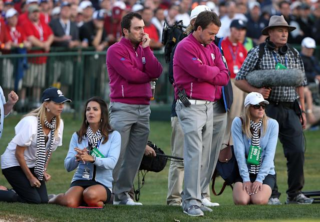 MEDINAH, IL - SEPTEMBER 29: Francesco Molinari, Graeme McDowell and the European wives watches the play during day two of the Afternoon Four-Ball Matches for The 39th Ryder Cup at Medinah Country Club on September 29, 2012 in Medinah, Illinois. (Photo by Ross Kinnaird/Getty Images)