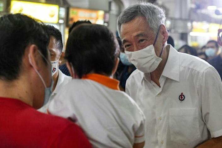 Prime Minister Lee Hsien Loong has sought to project his party as a force for stability that can guide Singapore through tough times (AFP Photo/Roslan RAHMAN)