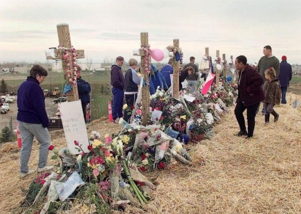 PHOTO: Mourners visit a memorial of crosses on a hill overlooking Columbine High School in Littleton, Colo., on May 1, 1999. (Ed Andrieski/AP)