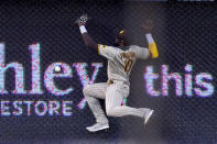 San Diego Padres left fielder Jurickson Profar can't get to a ball hit for a double by Los Angeles Dodgers' Justin Turner during the second inning of a baseball game Tuesday, Aug. 11, 2020, in Los Angeles. (AP Photo/Mark J. Terrill)
