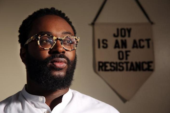 "Tyree Boyd-Pates, an L.A.-based historian and museum curator, has used digital advocacy to educate activists and their allies, including a set of ""Freedom Papers"" he has emailed out in the aftermath of George Floyd's death. <span class=""copyright"">(Dania Maxwell / Los Angeles Times)</span>"
