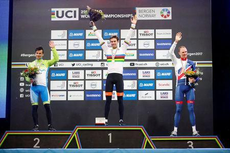 Cycling - UCI Road World Championships - Men Elite Individual Time Trial - Bergen, Norway - September 20, 2017 - Silver medalist Primoz Roglic of Slovenia, gold medalist Tom Dumoulin of the Netherlands and bronze medalist Chris Froome of Britain react on the podium. NTB Scanpix/Cornelius Poppe via REUTERS