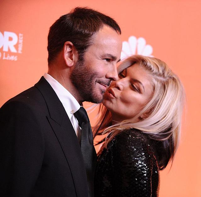 <p>The sexy singer smooched her date for the evening, designer Tom Ford, who accepted the Hero Award Sunday night at Trevor Project's 2017 TrevorLIVE LA ceremony. The Trevor Project is a national advocacy group focused on LGBTQ youth suicide prevention. (Photo: Jason LaVeris/FilmMagic) </p>
