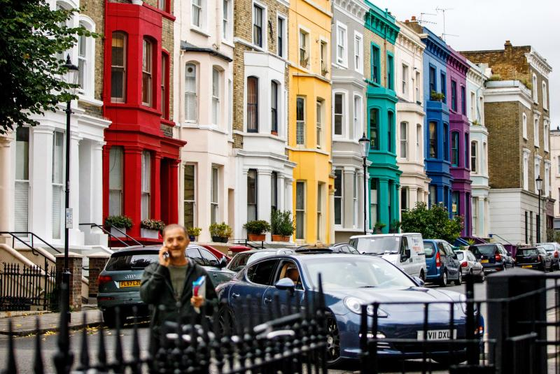 A row of painted houses is pictured in the Notting Hill district of west London, on August 8, 2017. Last week, The Bank of England cut its UK growth forecasts with governor Mark Carney warning that high inflation triggered by a Brexit-fuelled slump in the pound had hurt consumer spending. / AFP PHOTO / Tolga Akmen (Photo credit should read TOLGA AKMEN/AFP/Getty Images)