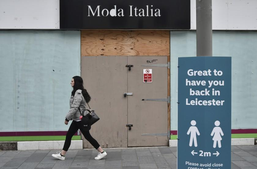 "A woman walks past a boarded-up shop in downtown Leicester, England, on Tuesday June 30, 2020. <span class=""copyright"">(Rui Vieira / Associated Press)</span>"