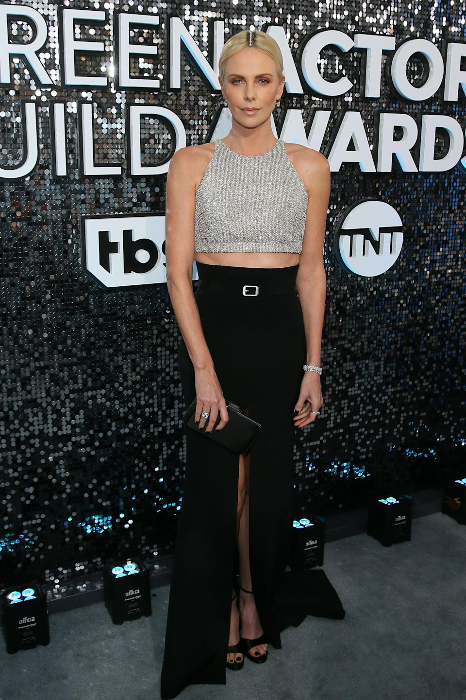 <h2>Charlize Theron in Dior</h2><br>Charlize Theron admitting that she used Tiffany & Co. diamonds to cover up her dark roots has to be the best line of the night. Oh, and her metallic two-piece look is pretty great too.