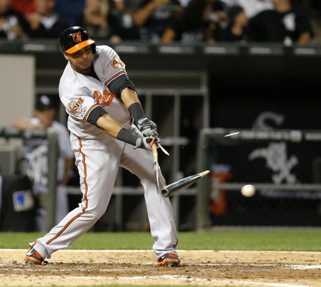 Baltimore Orioles' Nelson Cruz breaks his bat on a pitch from Chicago White Sox starting pitcher Jose Quintana and is thrown out at first by shortstop Alexei Ramirez, during the fourth inning of a baseball game Tuesday, Aug. 19, 2014, in Chicago. (AP Photo/Charles Rex Arbogast)