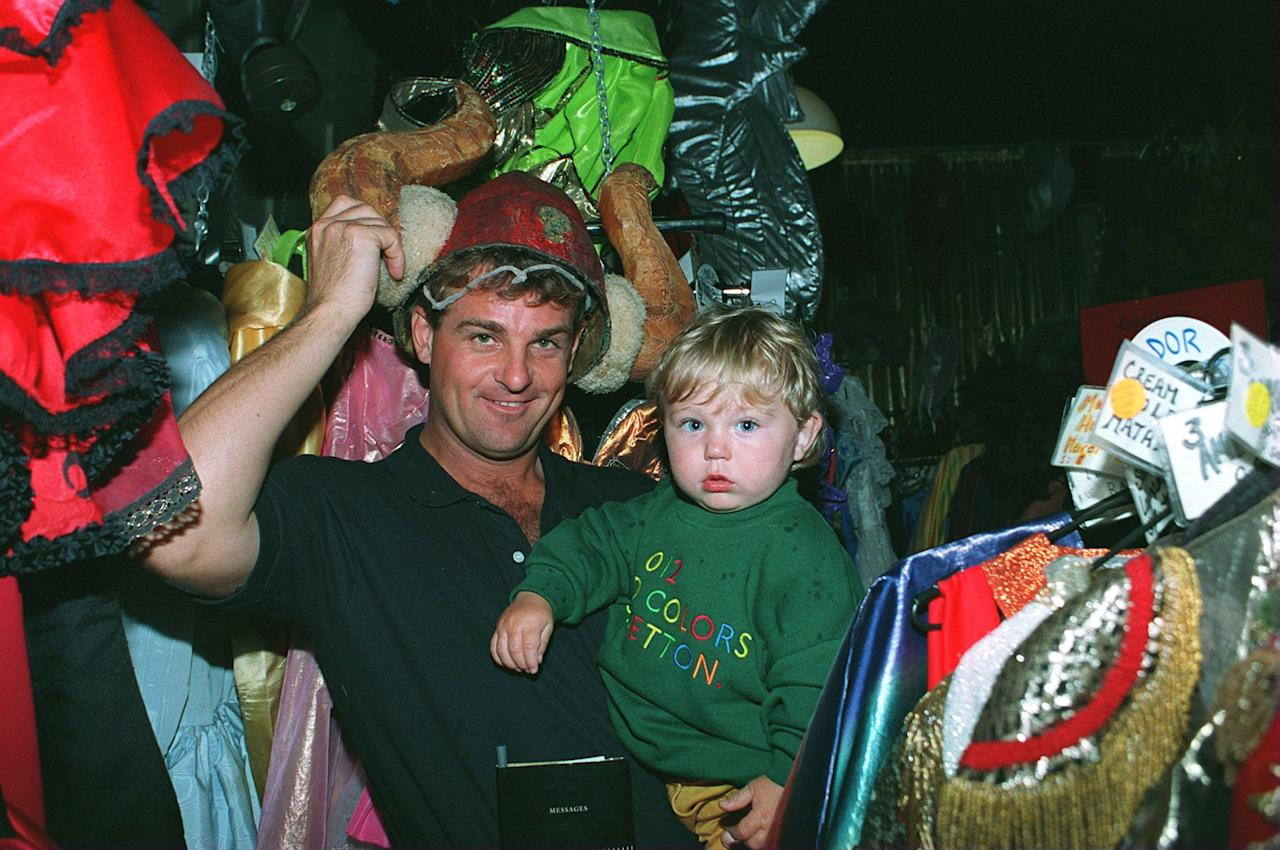 21 DEC 1994:  ENGLAND CRICKETERS  TRY THEIR FANCY DRESS OUTFITS ON FOR THE CHRISTMAS DINNER STEVE RHODES WITH HIS SON GEORGE  Mandatory Credit: Graham Chadwick/ALLSPORT