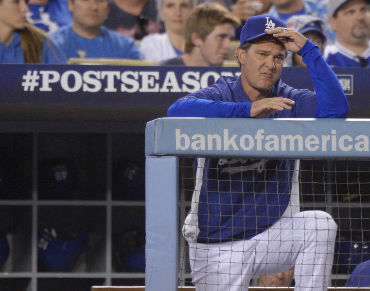 Los Angeles Dodgers manager Don Mattingly watches during the sixth inning of Game 4 of the National League baseball championship series against the St. Louis Cardinals Tuesday, Oct. 15, 2013, in Los Angeles. (AP Photo/Mark J. Terrill)