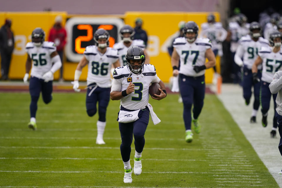 Seattle Seahawks quarterback Russell Wilson (3) runs onto the field before the start of the first half of an NFL football game against the Washington Football Team, Sunday, Dec. 20, 2020, in Landover, Md. (AP Photo/Andrew Harnik)