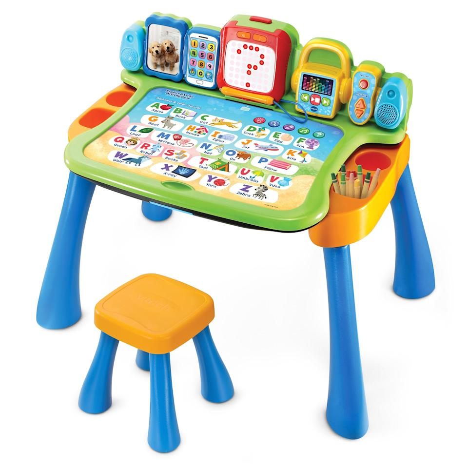 """<p>Winter days at home mean they'll never want to leave their <a href=""""https://www.popsugar.com/buy/VTech-Explore-amp-Write-Activity-Desk-362232?p_name=VTech%20Explore%20%26amp%3B%20Write%20Activity%20Desk&retailer=walmart.com&pid=362232&price=49&evar1=moms%3Aus&evar9=25895292&evar98=https%3A%2F%2Fwww.popsugar.com%2Ffamily%2Fphoto-gallery%2F25895292%2Fimage%2F45493553%2FVTech-Explore-Write-Activity-Desk&list1=gifts%2Choliday%2Ctoys%2Cgift%20guide%2Cgifts%20for%20kids%2Ckid%20shopping%2Choliday%20living%2Choliday%20for%20kids%2Cgifts%20for%20toddlers&prop13=api&pdata=1"""" rel=""""nofollow"""" data-shoppable-link=""""1"""" target=""""_blank"""" class=""""ga-track"""" data-ga-category=""""Related"""" data-ga-label=""""https://www.walmart.com/ip/VTech-Explore-Write-Activity-Desk/323780511"""" data-ga-action=""""In-Line Links"""">VTech Explore &amp; Write Activity Desk</a> ($49).</p>"""