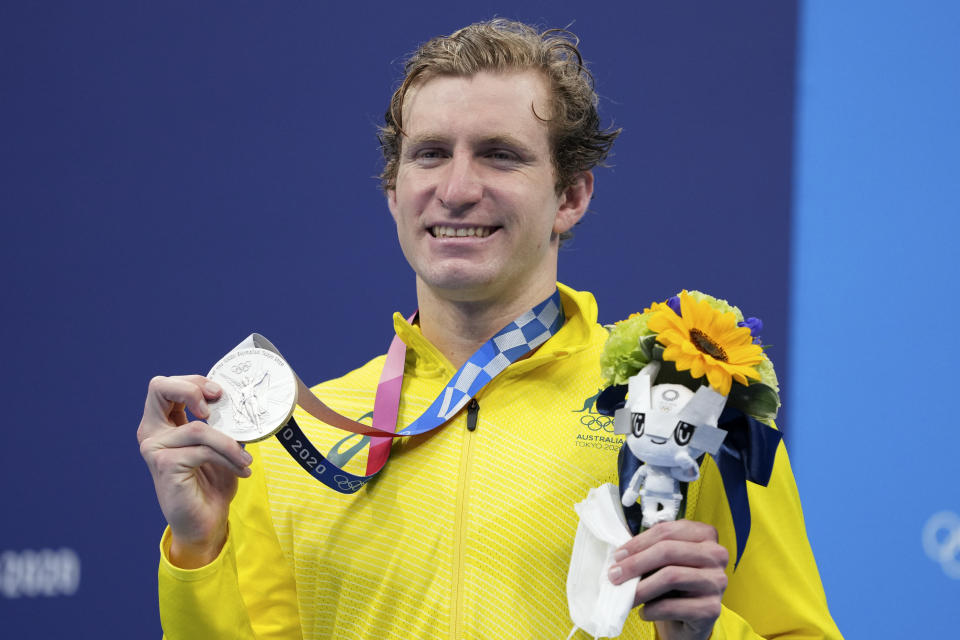 Jack McLoughlin, of the Australia, holds his silver medal on the podium after the final of the men's 400-meter freestyle at the 2020 Summer Olympics, Sunday, July 25, 2021, in Tokyo, Japan. (AP Photo/Matthias Schrader)