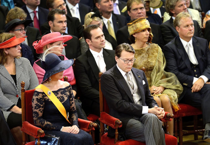 """Netherlands' Prince Constantijn, brother of King Willem-Alexander, front right and his wife Princess Laurentien, front left, attend the opening of the new parliamentary year by King Willem-Alexander with a speech in the 13th century """"Hall of Knights"""" in The Hague, Netherlands, Tuesday, Sept. 17, 2013. (AP Photo/Lex van Lieshout, Pool)"""