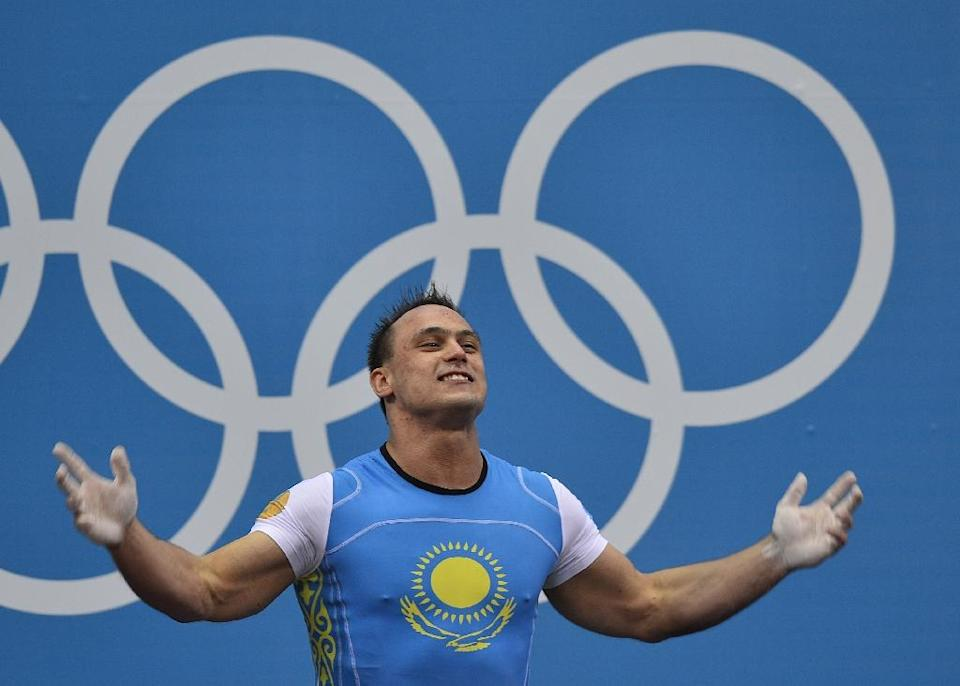 Kazakhstan's Ilya Ilyin celebrates his new Olympic record during the men's 94kg group A weightlifting event of the London 2012 Olympic Games (AFP Photo/Yuri Cortez)
