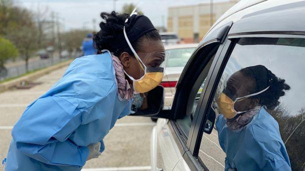 PHOTO: Dr. Ala Stanford leans into car to test an unidentified patient for COVID-19 in Philadelphia. (Pastor Marshall Mitchell via Black Doctors Covid19 Consortium)
