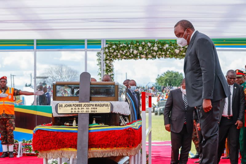 Kenya's President Uhuru Kenyatta pays respect at the coffin of the late Tanzanian President Magufuli during the State Funeral, in Dodoma