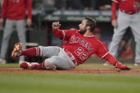Los Angeles Angels' David Fletcher scores on a double hit by Brandon Marsh during the third inning of a baseball game against the Seattle Mariners, Friday, Oct. 1, 2021, in Seattle. (AP Photo/Ted S. Warren)