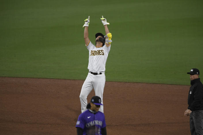 San Diego Padres' Yu Darvish stands on second base as he points skyward after hitting a double during the sixth inning of a baseball game against the Colorado Rockies, Monday, May 17, 2021, in San Diego. (AP Photo/Denis Poroy)