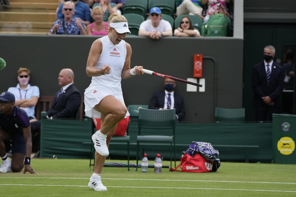 Germany's Angelique Kerber celebrates during the women's singles second round match against Spain's Sara Sorribes Tormo on day four of the Wimbledon Tennis Championships in London, Thursday July 1, 2021. (AP Photo/Alastair Grant)