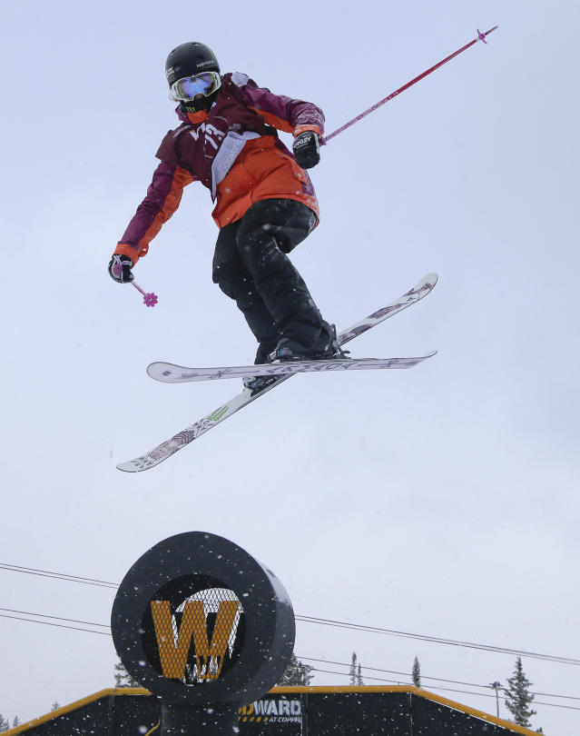 Maggie Voisin slides off a rail during the World Cup U.S. Grand Prix slopestyle freestyle skiing qualifications on Friday, Dec. 20, 2013, in Frisco, Colo. (AP Photo/Julie Jacobson)