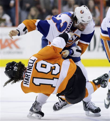 Philadelphia Flyers' Scott Hartnell (19) falls to the ice during a fight with New York Islanders' Colin McDonald (13) during the first period of an NHL hockey game, Thursday, March 28, 2013, in Philadelphia. (AP Photo/Matt Slocum)