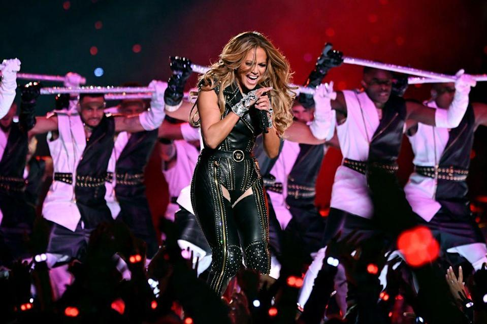 <p>Atelier Versace created Jennifer Lopez's outfits, including this leather look complete with chaps. </p>