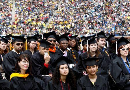Graduating students listen to U.S. President Barack Obama speak at the University of Michigan commencement ceremony in Ann Arbor, Michigan May 1, 2010. REUTERS/Kevin Lamarque