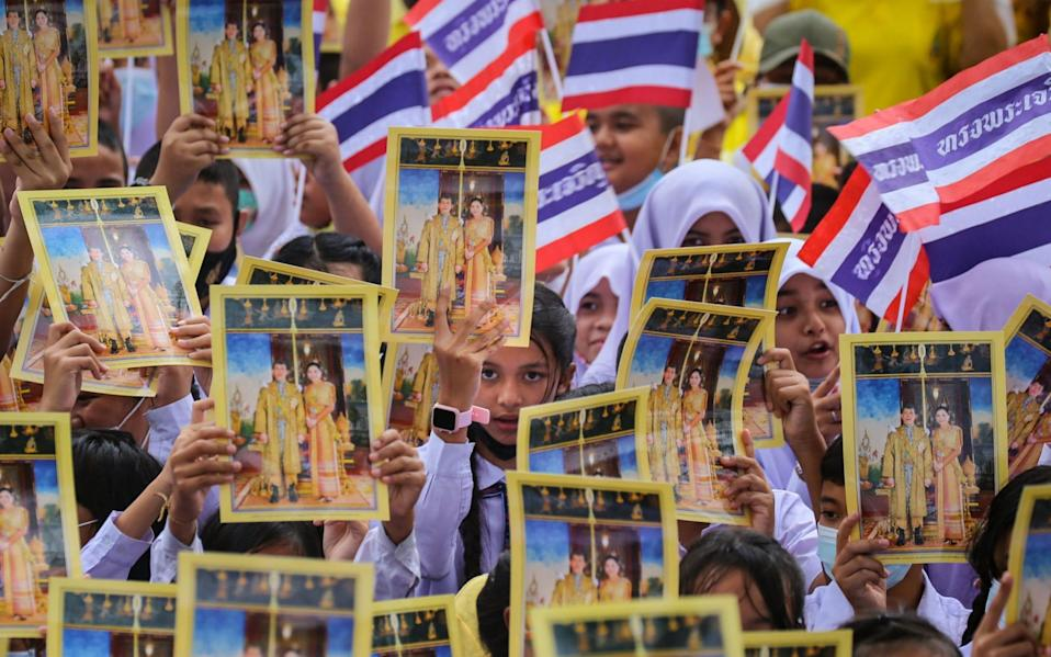 Students show support for the Thai royal establishment in a counter demonstration - TUWAEDANIYA MERINGING/AFP