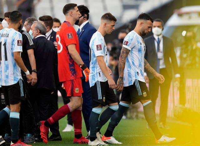 Argentina players leave the field in Sao Paulo after health officials forced the suspension of their World Cup qualifier against Brazil