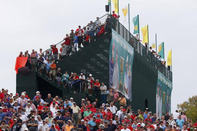 Fans watch the ninth green during the four ball matches at the 2013 Presidents Cup golf tournament at Muirfield Village Golf Club in Dublin, Ohio October 5, 2013. REUTERS/Jeff Haynes (UNITED STATES - Tags: SPORT GOLF)