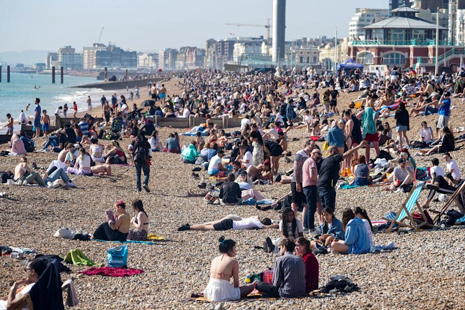 Crowds head for Brighton Beach as a spell of hot weather coincides with Covid lockdown restrictions being eased.