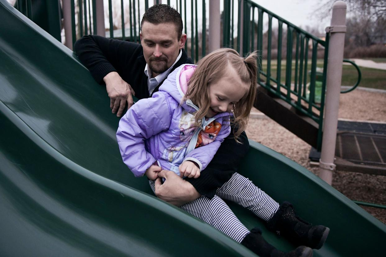 Sean Graves plays with his daughter, Olivia Graves, 3,