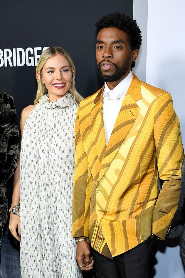 Sienna Miller and Chadwick Boseman attend a screening of