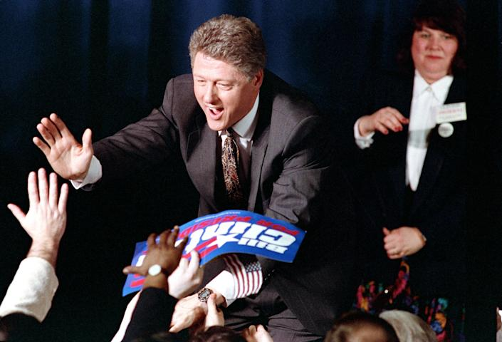 Bill Clinton with supporters during an election night party in Merrimack, N.H., Feb. 18, 1992. (Ron Frehm/AP)
