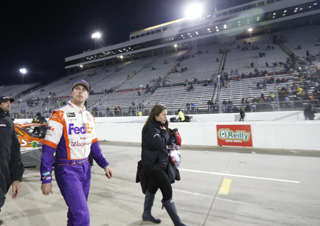 "<a class=""link rapid-noclick-resp"" href=""/nascar/sprint/drivers/1283/"" data-ylk=""slk:Denny Hamlin"">Denny Hamlin</a> leaves the track after the NASCAR Cup series auto race at Martinsville Speedway in Martinsville, Va., Sunday, Oct. 29, 2017. Hamlin wrecked with <a class=""link rapid-noclick-resp"" href=""/nascar/sprint/drivers/3311/"" data-ylk=""slk:Chase Elliott"">Chase Elliott</a> during the last few laps. (AP Photo/Steve Helber)"